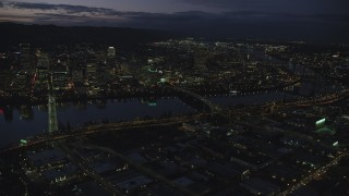 AX155_294 - 6K stock footage aerial video of skyscrapers in downtown and Willamette River bridges at night, Downtown Portland, Oregon