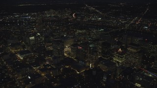 AX155_305 - 6K stock footage aerial video flying by Park Avenue West Tower and Fox Tower at night in Downtown Portland, Oregon