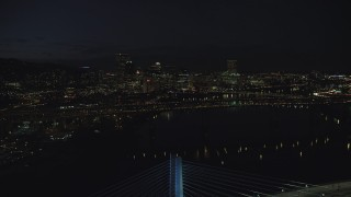 AX155_326 - 6K stock footage aerial video approaching Marquam Bridge and the Downtown Portland city skyline at night, Oregon