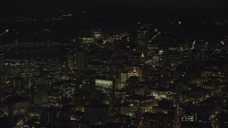 AX155_331 - 6K stock footage aerial video of Downtown high-rises and skyscrapers at night, Downtown Portland, Oregon