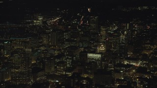 AX155_332 - 6K stock footage aerial video of Downtown US Bancorp Tower, high-rises and skyscrapers at night, Downtown Portland, Oregon