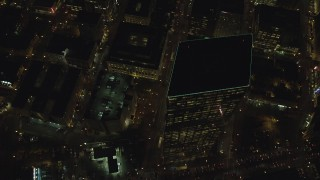 AX155_335 - 6K stock footage aerial video of a bird's eye view of SW 4th and SW 5th Avenue at night through Downtown Portland, Oregon, reveal US Bancorp Tower