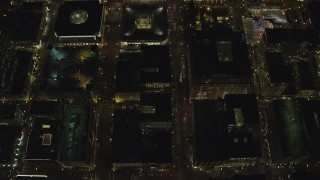 AX155_336 - 6K stock footage aerial video of a bird's eye of SW 4th and SW 5th Avenue at night through Downtown Portland, Oregon, reveal US Bancorp Tower