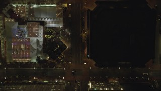 AX155_354 - 6K stock footage aerial video of a bird's eye of SW Broadway and Pioneer Courthouse Square at night in Downtown Portland, Oregon
