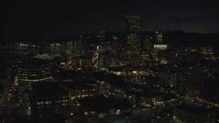 AX155_367 - 6K stock footage aerial video of US Bancorp Tower at nighttime seen from One Pacific Square, Downtown Portland, Oregon