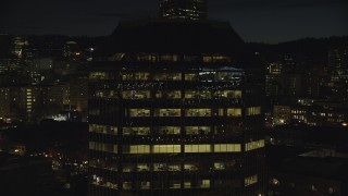 AX155_369 - 6K stock footage aerial video flying by One Pacific Square at night, Downtown Portland, Oregon