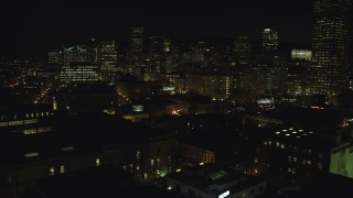 AX155_370 - 6K stock footage aerial video of Downtown Portland at night, and reveal the White Stag sign, Oregon