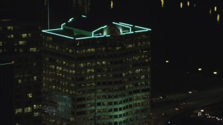 AX155_383 - 6K stock footage aerial video tracking Bank of America Financial Center at night in Downtown Portland, Oregon