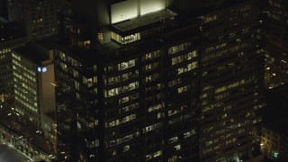 AX155_386 - 6K stock footage aerial video orbiting the top floors of Park Avenue West Tower at night in Downtown Portland, Oregon