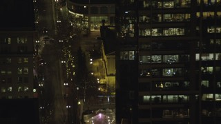 AX155_393 - 6K stock footage aerial video orbiting the Christmas tree in Pioneer Courthouse Square at night in Downtown Portland, Oregon