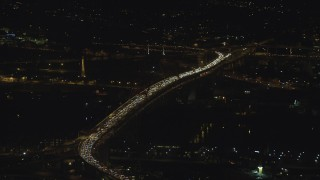 AX155_411 - 6K stock footage aerial video of heavy traffic congestion on the Fremont Bridge at night in Downtown Portland, Oregon