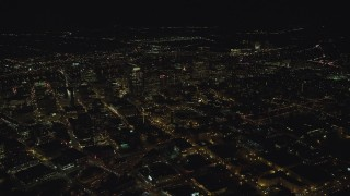 AX155_412 - 6K stock footage aerial video of an approach to high-rises and skyscrapers at night in Downtown Portland, Oregon