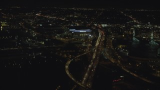 AX155_421 - 6K stock footage aerial video following I-5 to approach Moda Center at night in Northeast Portland, Oregon
