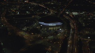 AX155_422 - 6K stock footage aerial video approaching Moda Center at night and tilt down in Northeast Portland, Oregon