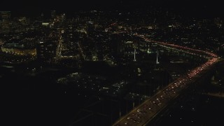 AX155_426 - 6K stock footage aerial video of heavy traffic on upper deck of Fremont Bridge near Downtown Portland, Oregon