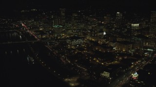 AX155_432 - 6K stock footage aerial video flying over Willamette River and Pacific Highway W toward Downtown Portland, Oregon