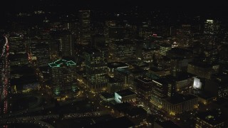 AX155_433 - 6K stock footage aerial video flying over Downtown Portland, Oregon at night, approach Standard Insurance Center