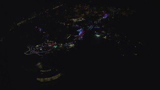 AX155_439 - 6K stock footage aerial video approaching and fly over the Oregon Zoo with holiday lights at night, Southwest Portland, Oregon
