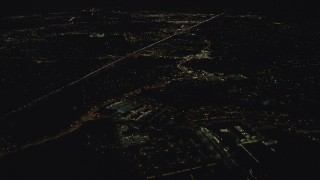 AX155_445 - 6K stock footage aerial video flying over apartment complex toward strip malls and suburban homes by Highway 26 at night, Beaverton, Oregon
