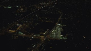 AX155_447 - 6K stock footage aerial video flying over strip mall by Highway 26 at night to approach neighborhood, Beaverton, Oregon