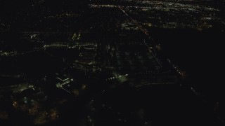 AX155_448 - 6K stock footage aerial video flying by Nike Headquarters office buildings at night, Beaverton, Oregon