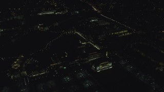 AX155_449 - 6K stock footage aerial video flying by the Nike Headquarters office buildings at night, Beaverton, Oregon