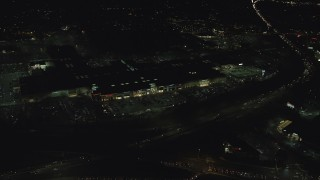 AX155_451 - 6K stock footage aerial video orbiting the Washington Square shopping mall at night in Tigard, Oregon
