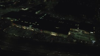 AX155_452 - 6K stock footage aerial video orbiting the Washington Square shopping mall at night in Tigard, Oregon