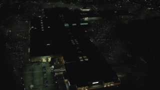 AX155_453 - 6K stock footage aerial video orbiting the Washington Square shopping mall at night in Tigard, Oregon
