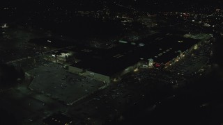 AX155_458 - 6K stock footage aerial video orbiting around Washington Square mall at nighttime in Tigard, Oregon
