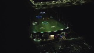 AX155_478 - 6K stock footage aerial video orbiting a Topgolf course in Hillsboro, Oregon at night
