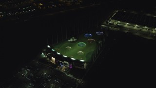 AX155_479 - 6K stock footage aerial video orbiting Topgolf course in Hillsboro, Oregon at night