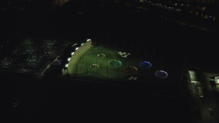 AX155_480 - 6K stock footage aerial video orbiting the Topgolf course in Hillsboro, Oregon at night