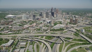 AX36_002 - 5K stock footage aerial video flying over freeways toward Downtown Atlanta skyscrapers, Georgia