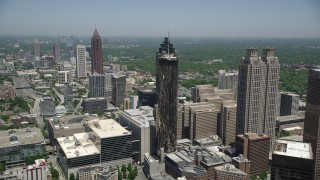 AX36_006 - 5K stock footage aerial video flying over office buildings near skyscrapers, Downtown Atlanta, Georgia