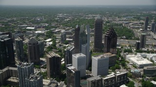 AX36_015 - 5K stock footage aerial video flying by skyscrapers revealing GLG Grand, Midtown Atlanta