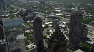 AX36_016 - 5K stock footage aerial video flying by tops of skyscrapers revealing Midtown Atlanta skyscrapers, Georgia