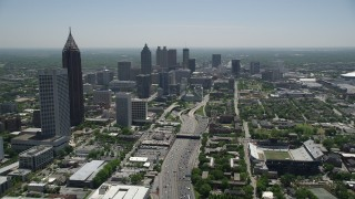 AX36_019 - 5K stock footage aerial video following Downtown Connector toward skyscrapers, Atlanta, Georgia