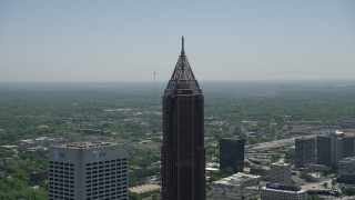 AX36_020 - 5K stock footage aerial video approaching the top of Bank of America Plaza, Midtown Atlanta, Georgia