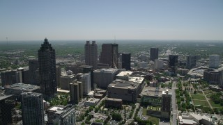 AX36_022 - 5K stock footage aerial video flying over high-rises and office buildings toward skyscrapers, Downtown Atlanta