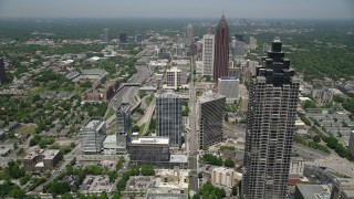 AX36_040 - 5K stock footage aerial video flying by SunTrust Plaza and over office buildings, Midtown Atlanta