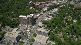 AX36_047 - 5K stock footage aerial video following a city road near a hospital, Buckhead, Georgia