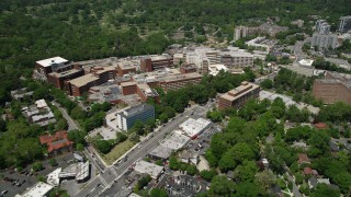 AX36_048 - 5K stock footage aerial video following Peachtree road revealing skyscrapers and wooded area, Buckhead