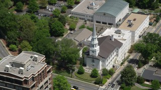 AX36_053 - 5K stock footage aerial video passing by a church on a street corner,  Buckhead, Georgia