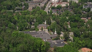 AX36_056 - 5K stock footage aerial video approaching a church nestled among trees, Buckhead, Georgia