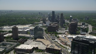 AX36_063 - 5K stock footage aerial video flying by skyscrapers and office buildings, Buckhead, Georgia