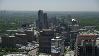 AX36_073 - 5K stock footage aerial video flying by skyscrapers and office buildings, Buckhead, Georgia