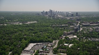AX36_081 - 5K stock footage aerial video tilting up from Peachtree Road to reveal Midtown Atlanta skyscrapers, Georgia
