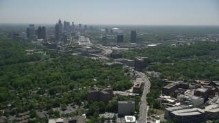 AX36_083 - 5K stock footage aerial video following Peachtree Road toward Midtown Atlanta skyline, Georgia
