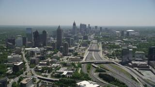 AX36_086 - 5K stock footage aerial video following Downtown Connector toward Midtown Atlanta skyscrapers, Georgia